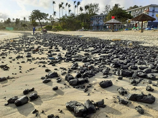 Solid oil spills in front of a Bintan Island resort