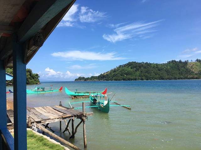 outrigger canoes in Kiluan Bay